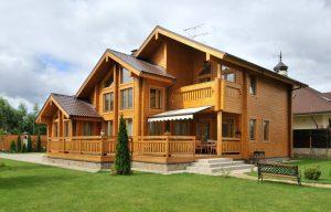 Деревянные коттеджи из бруса: особенности строительства
